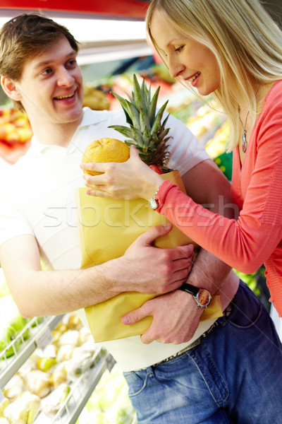 Stok fotoğraf: çift · süpermarket · portre · kadın · büyük · turuncu