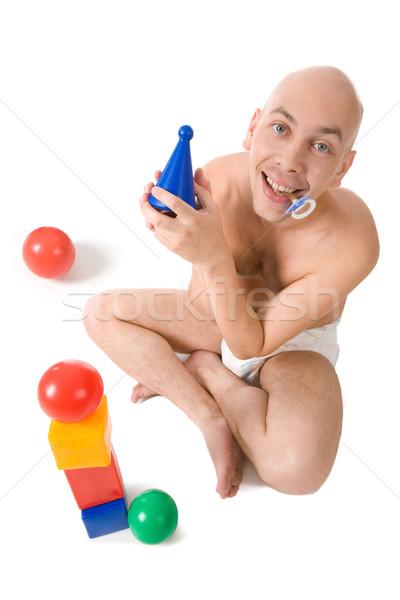 Jugando juguetes ángulo bebé hombre Foto stock © pressmaster