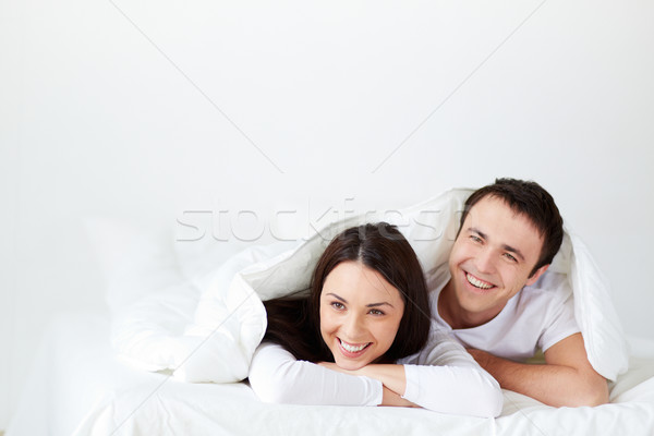 Joyeux couple portrait lit rire Photo stock © pressmaster