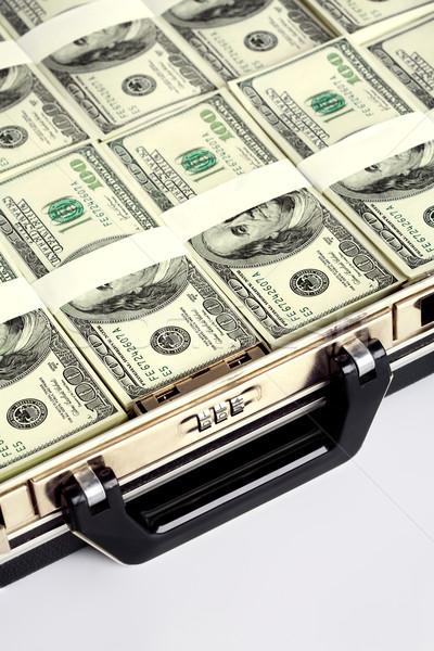 Briefcase full of dollars Stock photo © pressmaster
