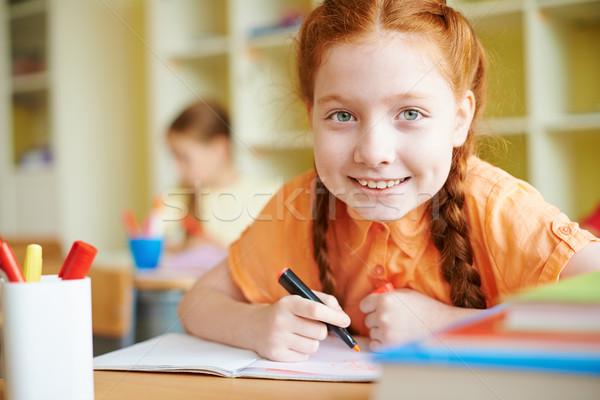 Stock photo: Girl drawing