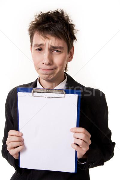 Bemutató portré fiatal üzletember üres papír néz Stock fotó © pressmaster