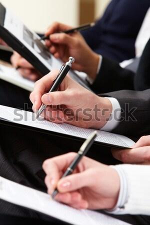 Escrito trabalhar humanismo mãos canetas Foto stock © pressmaster