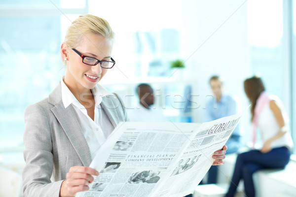 Woman with newspaper Stock photo © pressmaster