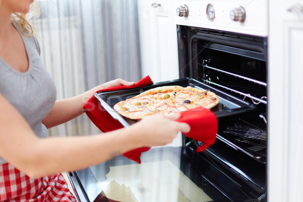 Cooking pizza Stock photo © pressmaster