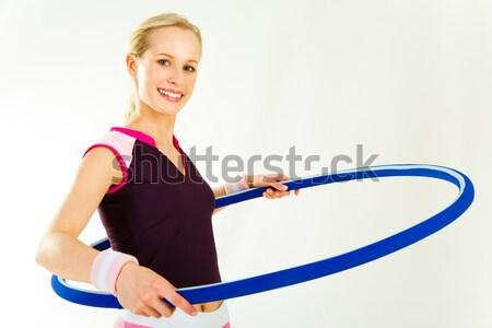 Uygun kadın omuz bakıyor kamera Stok fotoğraf © pressmaster