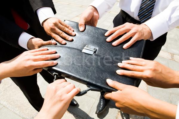 Briefcase in hands Stock photo © pressmaster