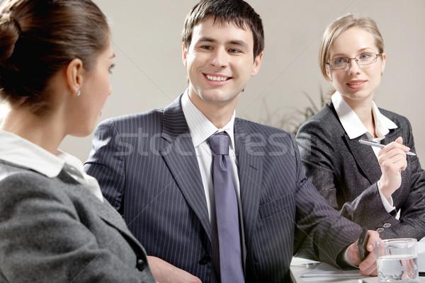 Conversa retrato feliz empresário olhando colega Foto stock © pressmaster
