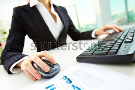 Stock photo: Hand on mouse