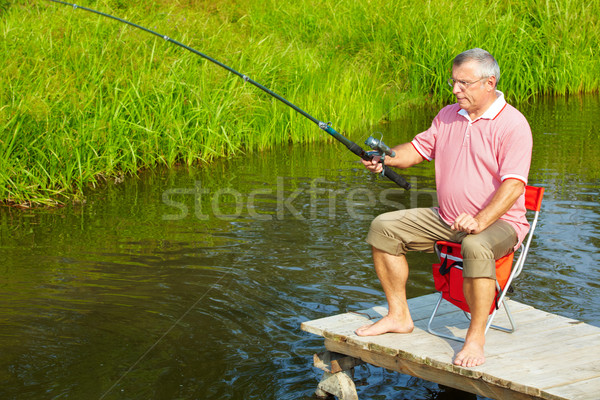 Senior man fishing Stock photo © pressmaster