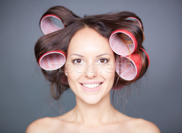 Woman with hair curlers Stock photo © pressmaster