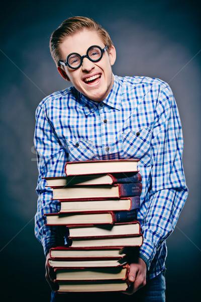 Könyvmoly portré fiatal fickó szemüveg köteg Stock fotó © pressmaster
