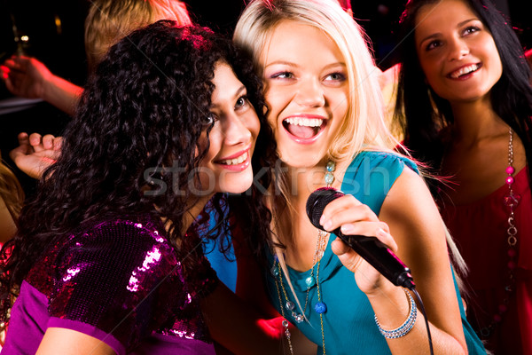 Singing girls Stock photo © pressmaster