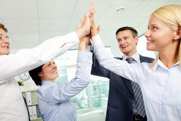 Successo squadra di affari holding hands insieme entusiasmo Foto d'archivio © pressmaster