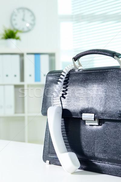 Briefcase and receiver Stock photo © pressmaster