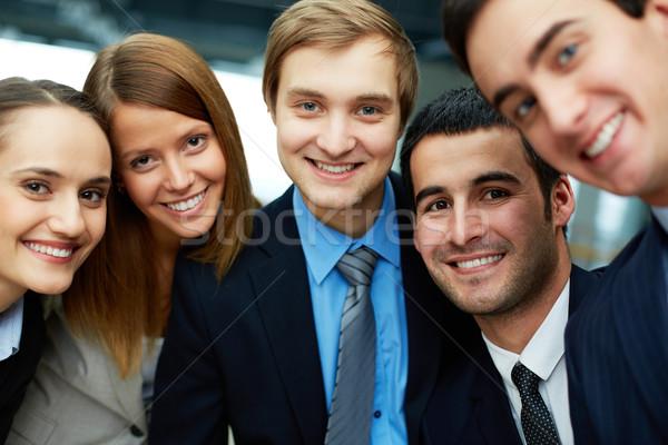 Stock fotó: üzleti · partnerek · portré · öt · néz · kamera · mosoly