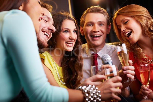 Singing at party Stock photo © pressmaster