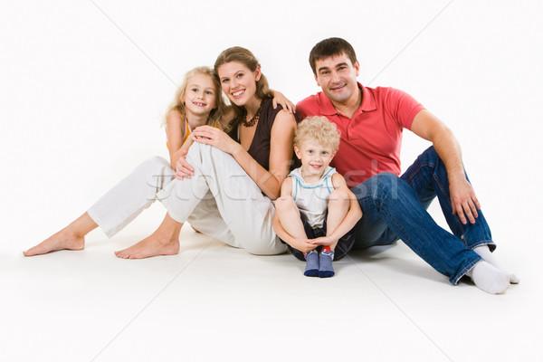 Seduta persone ritratto quattro sorridere insieme Foto d'archivio © pressmaster