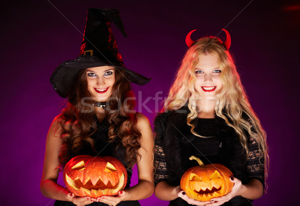 Stock photo: Women with pumpkins