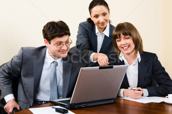 Business woman is explaining the correct way analysis to her col Stock photo © pressmaster