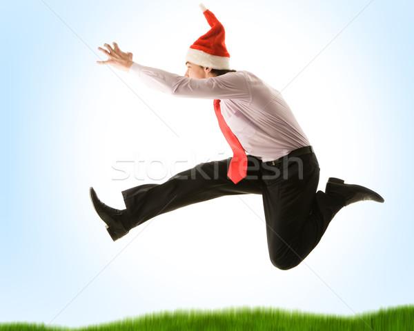 Dinamizmus örömteli üzletember ugrik magas nyújtás Stock fotó © pressmaster