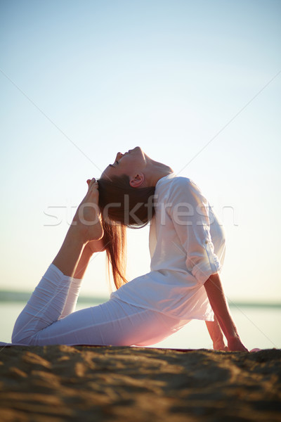 Yoga on beach Stock photo © pressmaster