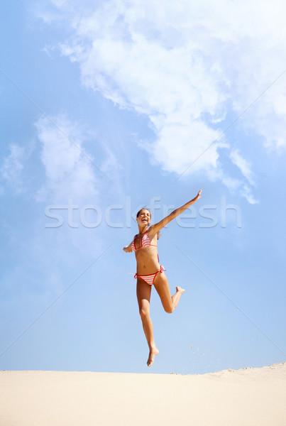 Joie portrait joyeux fille plage de sable vacances d'été Photo stock © pressmaster
