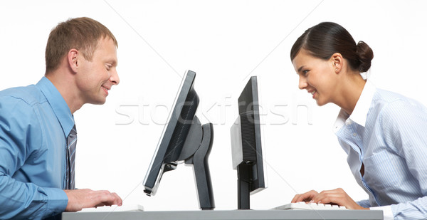 ül ellenkező kettő üzlet kollégák számítógép Stock fotó © pressmaster