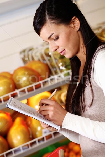Girl buying products Stock photo © pressmaster