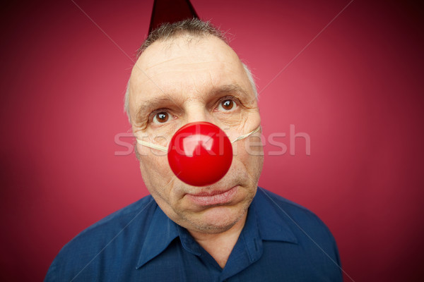 Unhappy man with red nose Stock photo © pressmaster
