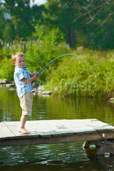 Kid fishing Stock photo © pressmaster