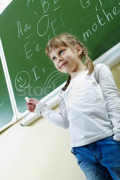 Girl by blackboard Stock photo © pressmaster