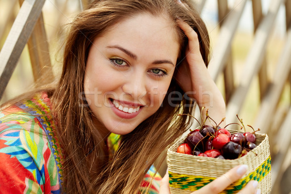 Woman with berries Stock photo © pressmaster