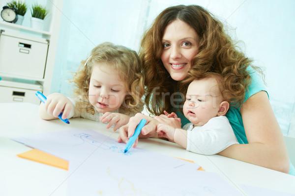 Interessante ocupação alegre família três crianças Foto stock © pressmaster