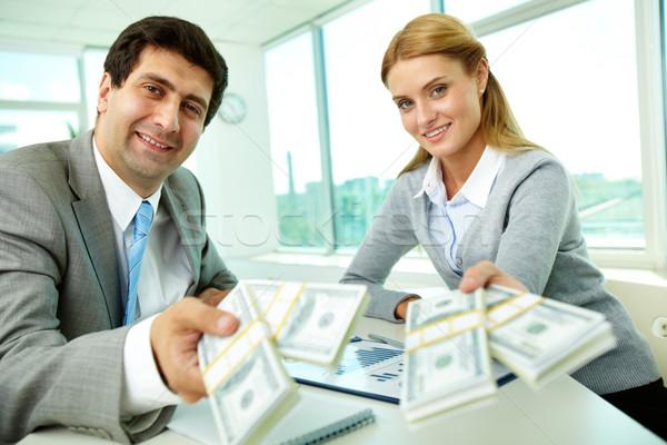 Bondade dois parceiros de negócios local de trabalho dinheiro olhando Foto stock © pressmaster