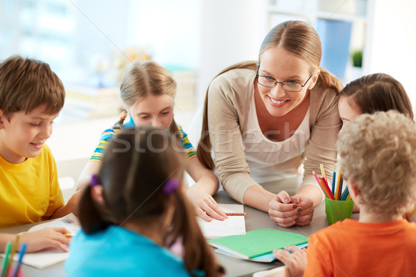 Beszél iskolás portré szorgalmas iskolás gyerekek tanár Stock fotó © pressmaster