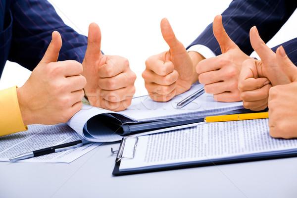 Başarı iş iş adamları kâğıt el kalem Stok fotoğraf © pressmaster