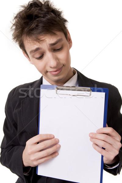 興味深い 情報 肖像 若い男 紙 発表 ストックフォト © pressmaster