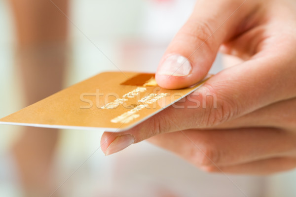 Card in hand Stock photo © pressmaster