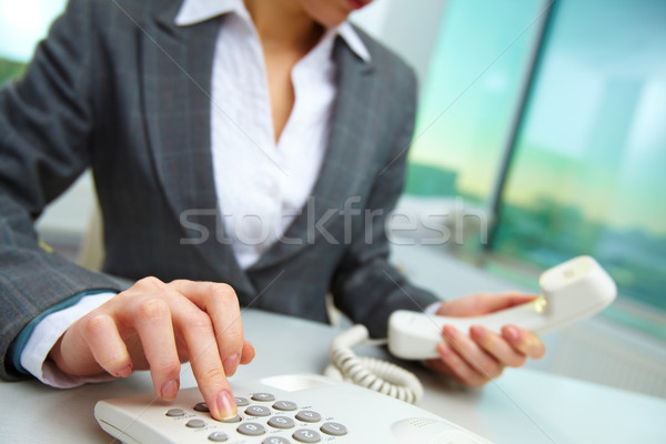 Pressing telephone buttons Stock photo © pressmaster