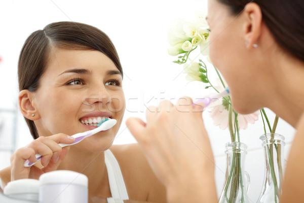 Polishing teeth Stock photo © pressmaster