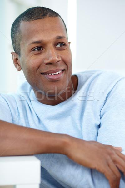 Higgadt fickó kép fiatal afrikai férfi Stock fotó © pressmaster