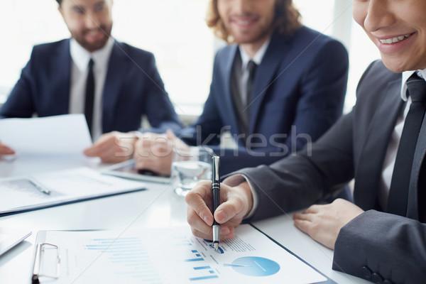 Wykresy trzy mężczyzn arkusz kalkulacyjny papieru Zdjęcia stock © pressmaster