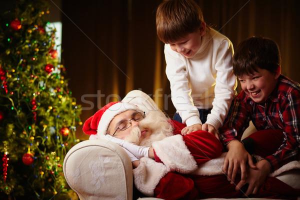 Święty mikołaj niegrzeczny chłopców w górę chłopca Zdjęcia stock © pressmaster