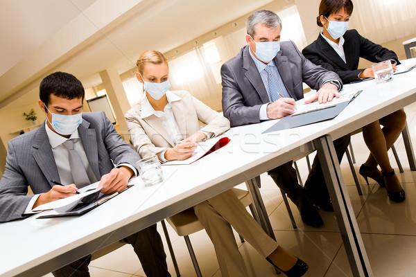 Working in masks Stock photo © pressmaster