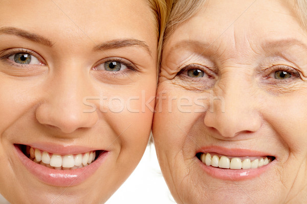 Close-up of two faces of beautiful woman and mother    Stock photo © pressmaster