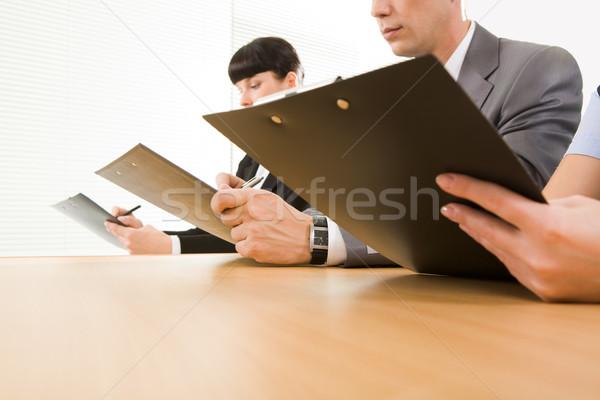 Convenzione fila umani mani giornali Foto d'archivio © pressmaster