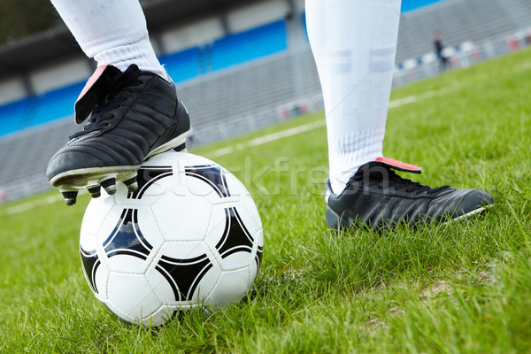 Stock photo: Foot on ball