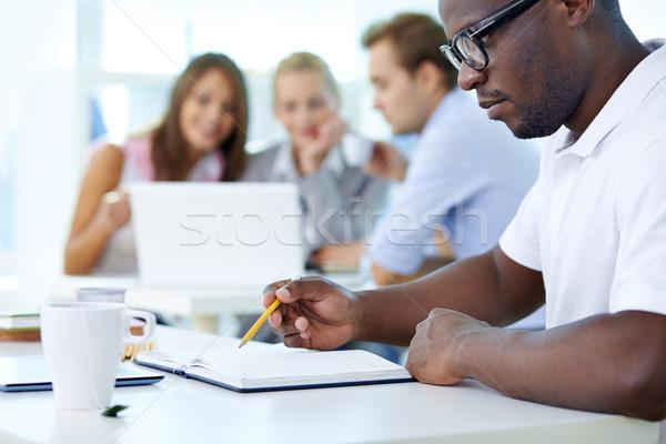Stok fotoğraf: Planları · konsantre · genç · ön · plan · planlama · öğrenci
