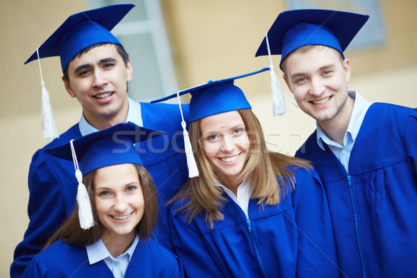 Friends in graduation gowns Stock photo © pressmaster